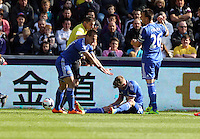 Sunday, 13 April 2014<br /> Pictured: John Terry (R) of Chelsea with team mates protesting to match referee Phil Dowd for a foul suffered by Andre Schurrle (C) by Chico Flores of Swansea (not pictured).<br /> Re: Barclay's Premier League, Swansea City FC v Chelsea at the Liberty Stadium, south Wales,