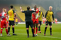 Uche Ikpeazu of Wycombe Wanderers speaks to the Referee during the Sky Bet Championship behind closed doors match between Watford and Wycombe Wanderers at Vicarage Road, Watford, England on 3 March 2021. Photo by David Horn.