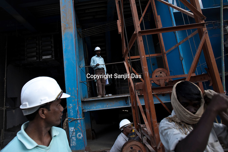 Indian workers at the construction site of the Adani Power plant of 4620 MW capacity in Mundra port industrial city of Gujarat, India. Indian power companies have handed out dozens of major contracts to Chinese firms since 2008. Adani Power Ltd have built elaborate Chinatowns to accommodate Chinese workers, complete with Chinese chefs, ping pong tables and Chinese television. Chinese companies now supply equipment for about 25% of the 80,000 megawatts in new capacity.
