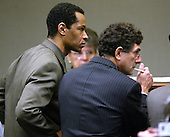 Sniper suspect John Allen Muhammad, left, listens during a bench conference along with his attorney Jonathan Shapiro, right, during court proceedings in Virginia Beach Circuit Court in Virginia Beach, Virginia on November 7, 2003. <br /> Credit: Tracy Woodward - Pool via CNP