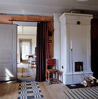 A series of patterned floor runners connects the various ground floor rooms of the house