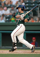 Outfielder Justin Bass (14) of the Greensboro Grasshoppers in a game against the Greenville Drive on June 14, 2010, at Fluor Field at the West End in Greenville, S.C. Photo by: Tom Priddy/Four Seam Images