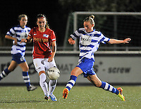 20130906 - OOSTAKKER , BELGIUM : Gent's Margaux Van Ackere (right) pictured with PVS 's Jeslynn Kuijpers during the female soccer match between AA Gent Ladies  and PSV / FC Eindhoven Dames , of the third matchday in the BENELEAGUE competition. Friday 06 th September 2013. PHOTO DAVID CATRY