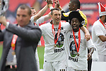 Reading 2 Swansea City 4, 30/05/2011. Wembley Stadium, Championship play-off final. Swansea players Stephen Dobbie and Nathan Dyer celebrate as manager Brendan Rodgers shows off the winners' trophy after the Npower Championship play-off final between Reading (blue) and Swansea City at Wembley Stadium. The match was won by Swansea by 4 goals to 2 watched by a crowd of 86,581. Swansea became the first Welsh team to reach the top division of English football since they themselves played there in 1983. Photo by Colin McPherson.