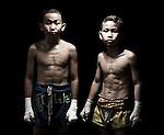 """10 years old Muay Thai Kickboxing figthers pose at Sangmorakot gymnasium in Bangkok, Thailand. Muay Thai, also know as """"Art of Eight Limbs"""", is a hard martial art and Thailand's national sport. Photo by Victor Fraile --- Image by © Victor Fraile"""