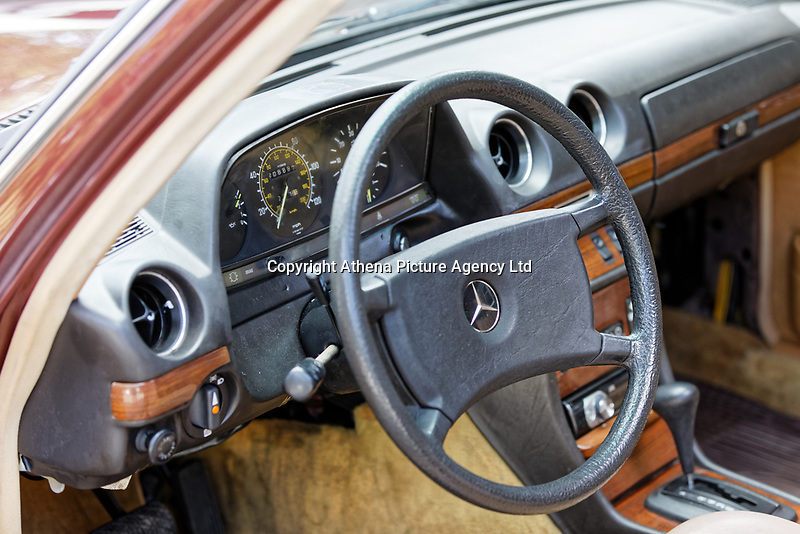 The steering wheel and organs of the 1979 Mercedes W123 300 Turbo Diesel from Missouri in the USA, at Gliffaes Hotel near Abergavenny, Wales, UK. Friday 24 August 2019
