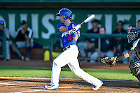 Brandon Montgomery (18) of the Ogden Raptors follows through on his swing against the Grand Junction Rockies during the Pioneer League game at Lindquist Field on August 25, 2016 in Ogden, Utah. The Rockies defeated the Raptors 12-3. (Stephen Smith/Four Seam Images)