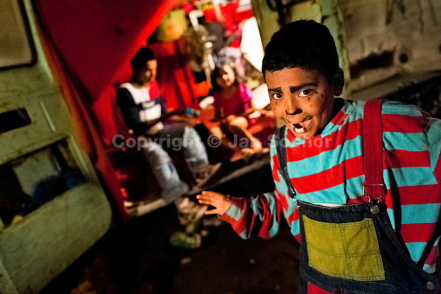 A Salvadorean boy, dressed up as a clown, performs in front of the trailer before a performance at the Circo Brasilia, a family run circus travelling in Central America, 10 May 2011. The Circo Brasilia circus belongs to the old-fashioned traveling circuses with a usual mixture of acrobat, clown and comic acts. Due to the general loss of popularity caused by modern forms of entertainment such as movies, TV shows or internet, these small family enterprises balance on the edge of survival. Circuses were pushed away and now they have to set up their shows in more remote villages. The circus art and culture is slowly dying in Latin America.