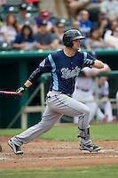 Corpus Christi Hooks first baseman Conrad Gregor (12) follows through on his swing during the Texas League baseball game against the San Antonio Missions on May 10, 2015 at Nelson Wolff Stadium in San Antonio, Texas. The Missions defeated the Hooks 6-5. (Andrew Woolley/Four Seam Images)