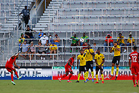 July 16th 2021; Orlando, Florida, USA; Jamaica players attempt to block a free kick by Guadeloupe forward Matthias Phaeton (10) during the Concacaf Gold Cup match between Guadeloupe and Jamaica on July 16, 2021 at Exploria Stadium in Orlando, Fl.