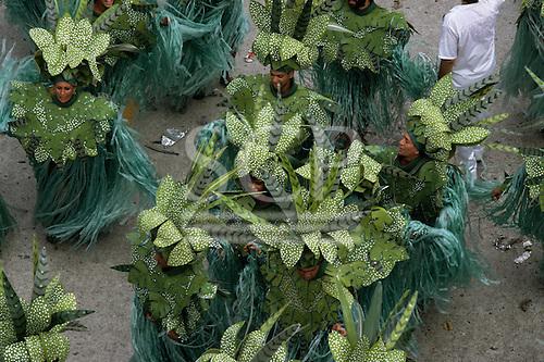 Rio de Janeiro, Brazil. Carnival: samba school in costumes representing rainforest trees and plants.