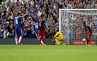 Pictured: Diego Costa of Chelsea (19) scores his hat trick third goal against Lukasz Fabianksi of Swansea (in yellow). Saturday 13 September 2014<br /> Re: Premier League Chelsea FC v Swansea City FC at Stamford Bridge, London, UK.