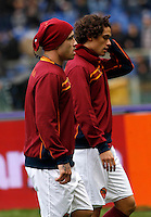 Calcio, Serie A: Roma-Genoa. Roma, stadio Olimpico, 12 gennaio 2014.<br /> AS Roma midfielder Radja Nainggolan, of Belgium, and defender Dodo', of Brazil, right, warm up prior to the start of the Italian Serie A football match between AS Roma and Genoa, at Rome's Olympic stadium, 12 January 2014. <br /> UPDATE IMAGES PRESS/Isabella Bonotto