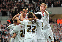 FAO: SPORTS PICTURE DESK<br /> Pictured: Leon Britton of Swansea (TOP L) is lifted by team mates celebrating his opening goal. Monday 16 May 2011<br /> Re: npower Championship play-offs 2nd leg, Swansea City FC v Nottingham Forest at the Liberty Stadium, Swansea south Wales.<br /> FAO: SPORTS PICTURE DESK<br /> Pictured: Monday 16 May 2011<br /> Re: npower Championship play-offs 2nd leg, Swansea City FC v Nottingham Forest at the Liberty Stadium, Swansea south Wales.