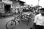 """A rickshaw on the streets of Barisal city, Bangladesh. Motor vehicles are still a relatively rare sight in this city of a quarter of a million people. Cycle rickshaws and bicycles are still the most popular form of transport..Bangladesh has been subjected to frequent natural disasters in recent years and the City of Barisal in Barisal District has been the headquarters for many aid agencies in their attempts to restore people's lives after the devastation wrought by Cyclone Sidr in November 2007.  The citizens of these areas of Southern Bangladesh are resilient in the face of constant threat from nature and these portraits reflect the determination of the people to continue living their lives as they have done for generations. .The borders of present-day Bangladesh were established with the partition of Bengal and India in 1947, when the region became the eastern wing of the newly formed Pakistan. However, it was separated from the western wing by 1,600 km (994 mi) across India. Political and linguistic discrimination as well as economic neglect led to popular agitations against West Pakistan, which led to the war for independence in 1971 and the establishment of Bangladesh. After independence the new state endured famines, natural disasters and widespread poverty, as well as political turmoil and military coups. The restoration of democracy in 1991 has been followed by relative calm and economic progress..Bangladesh is the seventh most populous country and is among the most densely populated countries in the world with a high poverty rate. However, per-capita (inflation-adjusted) GDP has more than doubled since 1975, and the poverty rate has fallen by 20% since the early 1990s. The country is listed among the """"Next Eleven"""" economies. Dhaka, the capital, and other urban centers have been the driving force behind this growth. Recent (2005-2007) estimates of Bangladesh's population range from 142 to 159 million, making it the 7th most populous nation in the world. Wit"""
