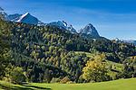 Germany, Bavaria, Upper Bavaria, Werdenfelser Land, hiking region upon Garmisch-Partenkirchen, at background Wetterstein mountains with summits Alpspitze, Zugspitze and Waxenstein, background rightmost summit Daniel 2.340 m, highest mountain of the Ammergau Alps located in Tirol (Austria) | Deutschland, Bayern, Oberbayern, Werdenfelser Land, Wanderregion oberhalb von Garmisch-Partenkirchen, im Hintergrund das Wettersteingebirge mit Alpspitze, Zugspitze und Waxenstein, ganz hinten rechts der Daniel mit 2.340 m hoechster Gipfel der Ammergauer Alpen im oesterreichischen Bundesland Tirol