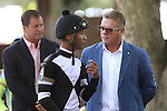 July 18, 2015: Kendrick Carmouche, who will ride Dukin' With Dale in the Kent Stakes, confers with the horse's trainer, John Servis, before the race. Syntax (IRE), Junior Alvarado up, wins the grade III Kent Stakes, one and 1/8 miles on the turf for 3 year olds at Delaware Park in Stanton DE.  Trainer is Bill Mott, owner is Randle Glosson.Joan Fairman Kanes/ESW/CSM