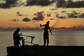 Fishing at sunset with a line off the jetty at Soufriere
