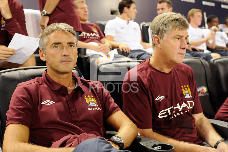 Manchester City F. C. manager Roberto Mancini on the bench before the match.  Sporting Clube de Portugal defeated Manchester City F. C. 2-0 during a Barclays New York Challenge match at Red Bull Arena in Harrison, NJ, on July 23, 2010.