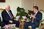 FILE PHOTO: Palestinian President Mahmoud Abbas (Abu Mazen) (L) meets with Egypt's President Mohamed Morsi at the presidential palace in Cairo July 18, 2012. Former President Mohamed Morsi died on Monday in court after the conclusion of a trial session in the espionage lawsuit, Egyptian state TV said. Photo by Thaer Ganaim