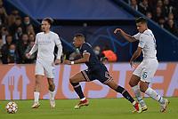 28th September 2021, Parc des Princes, Paris, France: Champions league football, Paris-Saint-Germain versus Manchester City:  Kylian Mbappe ( 7 - PSG ) goes past Rodri ( 16 - Manchester City )