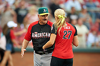 Oakland Athletics great Rollie Fingers shakes hands with softball legend Jennie Finch before the All-Star Legends and Celebrity Softball Game on July 12, 2015 at Great American Ball Park in Cincinnati, Ohio.  (Mike Janes/Four Seam Images)