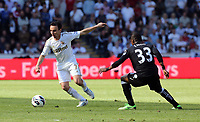 Pictured: (L-R) Leon Britton, Eyong Enoh.<br /> Sunday 19 May 2013<br /> Re: Barclay's Premier League, Swansea City FC v Fulham at the Liberty Stadium, south Wales.