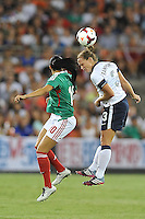 Christie Rampone (3) of the USWNT heads the ball against Renae Cuellar (10) of Mexico.  The USWNT defeated Mexico 7-0 during an international friendly, at RFK Stadium, Tuesday September 3 , 2013.