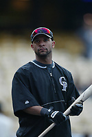 Jay Payton of the Colorado Rockies during a 2003 season MLB game at Dodger Stadium in Los Angeles, California. (Larry Goren/Four Seam Images)