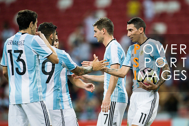 Angel Di Maria of Argentina celebrates with teammates after scoring his goal during the International Test match between Argentina and Singapore at National Stadium on June 13, 2017 in Singapore. Photo by Marcio Rodrigo Machado / Power Sport Images