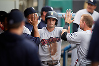 Scranton/Wilkes-Barre RailRiders shortstop Tyler Wade (23) high fives with teammates in the dugout during a game against the Syracuse Chiefs on June 14, 2018 at NBT Bank Stadium in Syracuse, New York.  Scranton/Wilkes-Barre defeated Syracuse 9-5.  (Mike Janes/Four Seam Images)