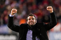 D. C. United head coach Ben Olsen salutes the fans after the match. D. C. United defeated the New York Red Bulls 1-0 (2-1 in aggregate) during the second leg of the MLS Eastern Conference Semifinals at Red Bull Arena in Harrison, NJ, on November 8, 2012.