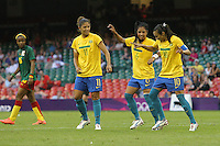 MARTA of Brazil scores the third goal from the penalty spot and celebrates by dancing with her team mates - Brazil Women vs Cameroon Women - Womens Olympic Football Tournament London 2012 Group E at the Millenium Stadium, Cardiff, Wales - 25/07/12 - MANDATORY CREDIT: Gavin Ellis/SHEKICKS/TGSPHOTO - Self billing applies where appropriate - 0845 094 6026 - contact@tgsphoto.co.uk - NO UNPAID USE.