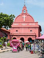 Christ Church, Built 1753.  Trishaw on left, waiting for tourist passenger. Melaka, Malaysia.