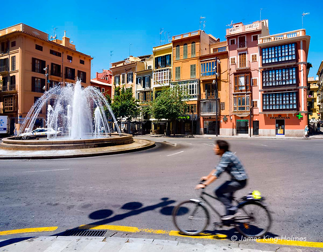 Plaça de la Reina, Palma de Mallorca, Spain lies at the southern end of Passeig d'es Born, a major tourist street in central Palma. The fountain and traffic roundabout date from the 19th century.