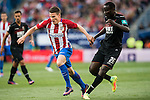 Kevin Gameiro (l) of Atletico de Madrid fights for the ball with Victorien Angban of Granada CF during their La Liga match between Atletico de Madrid and Granada CF at the Vicente Calderon Stadium on 15 October 2016 in Madrid, Spain. Photo by Diego Gonzalez Souto / Power Sport Images