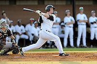 Third baseman Jake Beaver (11) of the University of South Carolina Upstate Spartans bats in a game against the College of Charleston Cougars on Tuesday, March 31, 2015, at Cleveland S. Harley Park in Spartanburg, South Carolina. Charleston won, 10-0. (Tom Priddy/Four Seam Images)