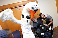 Pictured: Cyril the Swan and Neil Taylor Tuesday 06 December 2016<br />Re: Swansea City FC Christmas Party at the Liberty Stadium, Wales, UK