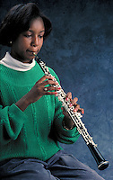 Oboe played by a young Afro-American female.  May not be used in an elementary school dictionary. Cleveland Ohio USA.