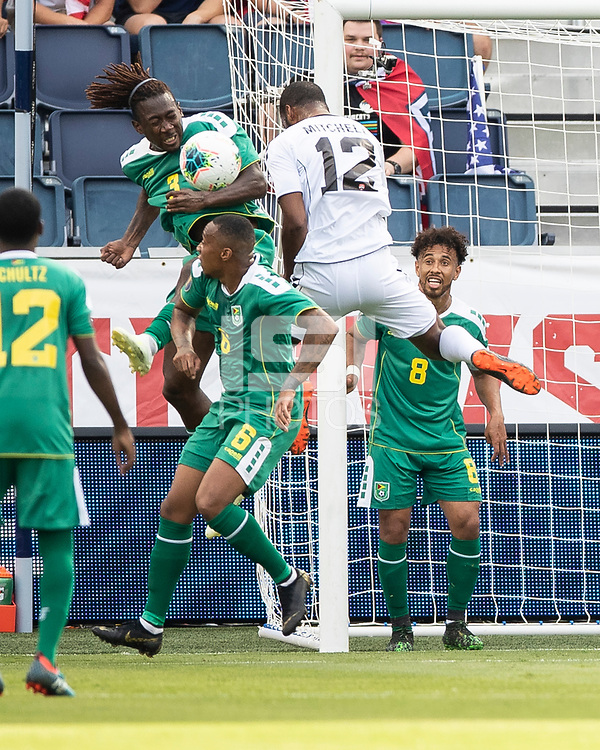 KANSAS CITY, KS - JUNE 26: Daniel Kadell #3 and Carlyle Mitchell #12 vie for the ball in front of the goal during a game between Guyana and Trinidad