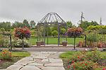 Pergola,and Rose Garden Plaza in Garden Green.  Oregon Gardens, Silverton, Oregon, USA, an 80 acre botanical garden in the Willamette Valley.  Wet day.