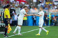 Jack Wilshere of England is replaced by Steven Gerrard of England after taking a knock to his ankle