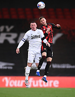31st October 2020; Vitality Stadium, Bournemouth, Dorset, England; English Football League Championship Football, Bournemouth Athletic versus Derby County; Chris Mepham of Bournemouth competes in the air with Wayne Rooney of Derby County
