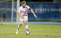 GEORGETOWN, GRAND CAYMAN, CAYMAN ISLANDS - NOVEMBER 19: Tim Ream #13 of the United States moves with the ball during a game between Cuba and USMNT at Truman Bodden Sports Complex on November 19, 2019 in Georgetown, Grand Cayman.
