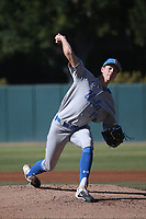 Jared Karros (19) of the UCLA Bruins pitches against the USC Trojans at Dedeaux Field on March 28, 2021 in Los Angeles, California. UCLA defeated USC, 13-1. (Larry Goren/Four Seam Images)