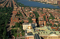 Aerial shot of Beacon Hill featuring the Massachusetts State House in the foreground and the Charles River in the background. Boston, Massachusetts.