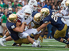 Sept. 26, 2015; Notre Dame defense brings down UMass running back Andy Isabella in the first half at Notre Dame Stadium. (Photo by Barbara Johnston/University of Notre Dame)