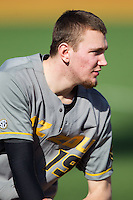 Alec Rash (19) of the Missouri Tigers watches the action from the dugout during the game against the Radford Highlanders at Wake Forest Baseball Park on February 21, 2014 in Winston-Salem, North Carolina.  The Tigers defeated the Highlanders 15-3.  (Brian Westerholt/Four Seam Images)