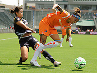 Sky Blue FC Natasha Kai gets taking down by Los Angeles Sol's Han Duan in the second half. Sky Blue FC won 1-0 over teh Sol at the Home Depot Center on Saturday, Aug. 22. 2009, in Carson, California. .