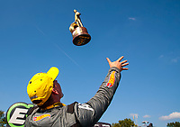 Sep 2, 2019; Clermont, IN, USA; NHRA pro stock drover Alex Laughlin tosses his Wally trophy in the air as he celebrates after winning the US Nationals at Lucas Oil Raceway. Mandatory Credit: Mark J. Rebilas-USA TODAY Sports